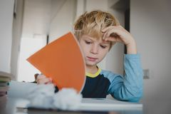 Difficult homework- little boy having problems with reading royalty free stock photography