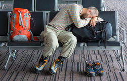 Difficult journey Man sleeping on his luggage Stock Image