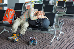 Difficult journey Man sleeping on his luggage Royalty Free Stock Photography
