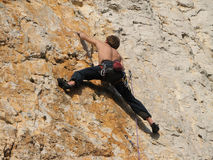 Difficult move. Young man climbing a difficult route, Crni Kal, Slovenija Stock Image
