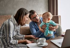 Difficult parenting - Angry baby boy. With parents stock photography