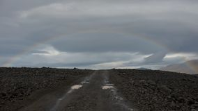 The difficult path to the glacier with rainbow, Iceland. The difficult path to the glacier with rainbow, West Iceland Stock Image