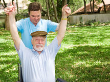 Difficult Physical Therapy. Senior man with arthritis is not enjoying his physical therapy session Royalty Free Stock Images