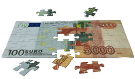 Difficult puzzle. Bank note one hundred euros and five thousand rubles split on puzzle pieces and try to put together in one note Royalty Free Stock Images