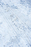 Difficult road conditions. An image of snow, ice and tire tracks on a road surface revealing the danger of skidding and of accidents and increased stopping Stock Photos