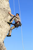 Difficult rock climbing position on horizontal cliff, mountains Royalty Free Stock Images