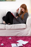 Difficult schoolwork at home. A student dealing with a difficult task for school Royalty Free Stock Photography