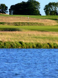A Difficult Shot. The view from the tee over a pond and then the green area of the 16th hole Stock Photos