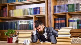 Difficult subject, confusing question concept. Difficult subject, confusing question, study, education, hard work, intellectual research concept. Man sits at royalty free stock photos