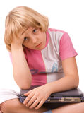 Difficult sum. Ten years old girl with laptop Stock Images