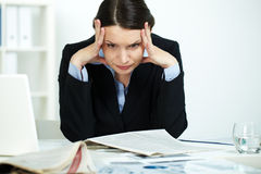 Difficult task. Portrait of stressed office worker in trouble Royalty Free Stock Images