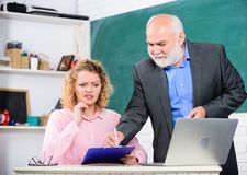 Difficult tasks. Knowledge test. High school college university. Lecturer educator helping student with test. Pass exam royalty free stock images