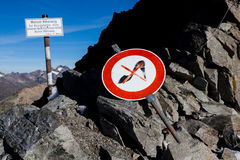 Difficult terrain. Sign warning against difficult terrain on a mountain path Stock Photography