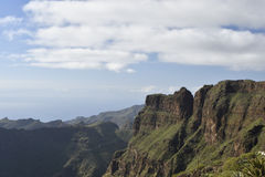 Difficult terrain with steep mountains and Ravines. And blue sky in background, picture from the South part of Tenerife Island Royalty Free Stock Photo