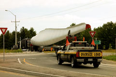 A difficult turn at a roundabout. A long truck carrying a massive wind turbine blade trying to navigate as seen in southern ontario Royalty Free Stock Photos
