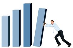 Difficult work. Creative photo of modern businessman trying to put column of graph into place Stock Image