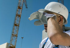Difficult work. Tired builder on blue sky background Stock Photography