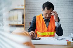 Difficult work. Pensive professional architect working on housing project Royalty Free Stock Image