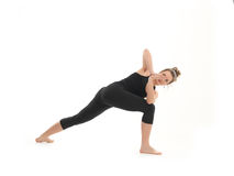 Difficult yoga pose demo Royalty Free Stock Photography