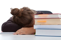 Difficulties with learning. Girl lying on a desk stock photos