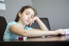 Difficulties with learning. A teen with difficulties with learning at home Royalty Free Stock Photos