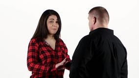 Difficulties in relationships, angry woman arguing with her man. White stock footage