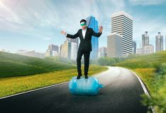 Businessman blindfolded, risk in business concept. Difficults and risk in business concept. Businessman blindfolded is on an unexplored way Royalty Free Stock Photography