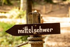 Difficulty levels in german. Medium difficulty sign in german in a park Royalty Free Stock Photography