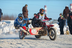 Difficulty turning. BORODINO, RUSSIA - FEBRUARY 5: Motorcycles with a sidecar at the all-Russian motocross named VP Chkalov, the organizer of the Auto-motorcycle Stock Photography