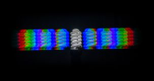 Diffraction of light from the energy-saving lamps, obtained by the grating Royalty Free Stock Photo