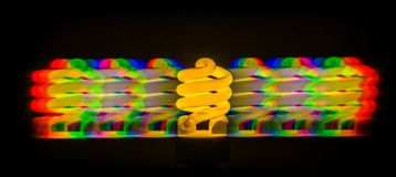 Diffraction of light from the energy-saving lamps, obtained by the grating Stock Images