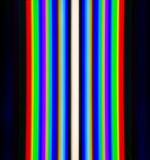Diffraction of light from the fluorescent lamps, obtained by the grating Stock Photos