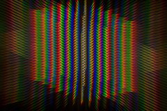Diffraction of light from the LED lamp on the grating Royalty Free Stock Photography