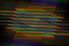 Diffraction of light from the LED lamp on the grating Royalty Free Stock Images