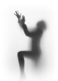 Diffuse silhouette of a praying human Royalty Free Stock Images