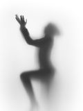 Diffuse silhouette of a praying human Stock Photos
