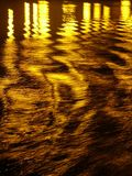 Diffused Light. Light reflection on evening water royalty free stock image