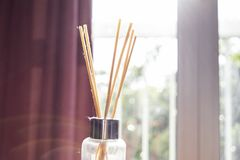 Diffuser in room with rattan sticks stock image