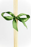 Diffuser sticks and green bow Royalty Free Stock Photography