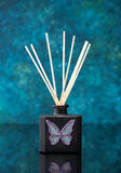 Diffuser with wooden wooden sticks Royalty Free Stock Photo