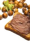 Diffusione, pane tostato e nocciole della nocciola fotografia stock libera da diritti