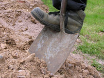 Dig 2. Boot pushing spade into earth stock images