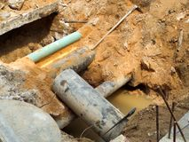 Dig dirt to underground pipes repair or replacement. Dig dirt to underground pipes for repair or replacement maintanance stock photo