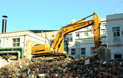 Dig machine. Construction next to the house Stock Images
