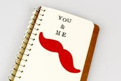 Dig och mig text i emty bok eller dagbok Royaltyfri Foto