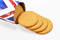Digestive biscuits and tinplate can. Digestive biscuits tinplate can on white background Stock Photo