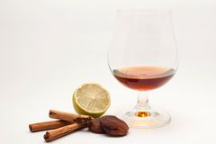 Digestive. Spirit in a glass with spices and flavors, isolated Royalty Free Stock Image