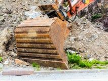Digger φτυάρι εκσκαφέων στο εργοτάξιο οικοδομής Στοκ Φωτογραφία