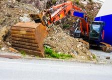 Digger φτυάρι εκσκαφέων στο εργοτάξιο οικοδομής Στοκ Εικόνα