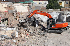 Digger 03. Concrete Munching Digger on Demolition Site Stock Photo